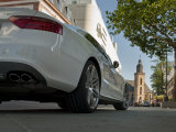 White Bmw Sports Car Parks at City Center in Frankfurt Square Photographic Print by Greg Dale