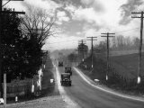 Cars Drive on the State Highway Stretching East to West Photographic Print by Edwin L. Wisherd
