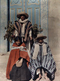 Three Poncho-Clad Quichua Indians Stand in Front of a Colorful Door Photographic Print by Jacob Gayer