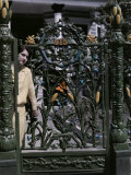 Young Man Stands by a Iron Fence, Decorated with Corn Stalks Photographic Print by Edwin L. Wisherd