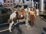 Cowgirl Puts a Nickel in an El Paso Parking Meter to Hitch Her Pony Photographic Print by Luis Marden