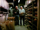 3rd Generation Italian, Holds a Loaf of Semolina Bread at His Bakery Photographic Print by  xPacifica