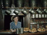 Woman Stands Behind Bar Loaded with Sandwiches at 17th Century Inn Photographic Print by B. Anthony Stewart