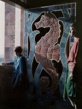 Child and an Adult Stand by a Tiled Sea Horse at the Carillon Tower Photographic Print by Clifton R. Adams