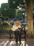 Old Man Falls Asleep on a Park Bench in El Jardin Photographic Print by  xPacifica