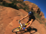 Blur Photo of a Woman Mountain Biking Through the Red Desert Photographic Print by Kate Thompson