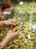 Shoppers Examine Gold Watches in a Shop in Little India, Singapore Photographic Print by  xPacifica