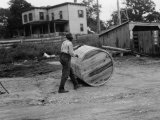 Man Rolls a Barrel of Tobacco Down to the Wharf for Shipment Photographic Print by Edwin L. Wisherd