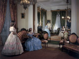 Women in Period Costumes Sit in an Antebellum Mansion's Drawing Room Photographic Print by Willard Culver