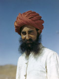 Man Wears a Red Turban Wrapped in Peasant Style Photographic Print by Volkmar K. Wentzel