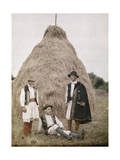 Three Men in Holiday Apparel Pose by a Large Hay Stack Photographic Print by Wilhelm Tobien