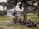 Schoolboys Sit in the Shade of a Tree Outside a Rural Schoolhouse Photographic Print by B. Anthony Stewart