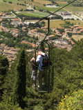 Couple Kissing in a Funicular over the Countryside of Gubbio Photographic Print by  xPacifica