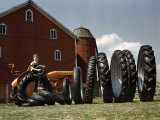 Boy Poses with Huge Rubber Tractor Tires Photographic Print by Willard Culver
