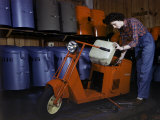 Woman Works on a Cushman Scooter for the War Effort Photographic Print by B. Anthony Stewart