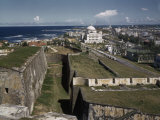 Worn San Cristobal Fort Sits in Contrast to the Modern Capitol Photographic Print by Edwin L. Wisherd
