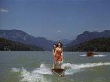 Two Women Water Ski on Lake Lure, Another Speedboat Follows Fotografisk trykk av Joseph Baylor Roberts