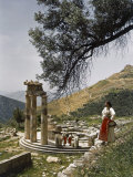 Three Restored Doric Columns Stand at the Ancient Greek Tholos Photographic Print by B. Anthony Stewart