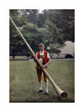 Swiss Man Stands with an Alphorn Instrument Photographic Print by Hans Hildenbrand