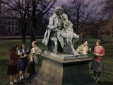 Students Stand Beside Statue of Thomas H. Gallaudet on Campus Lawn Photographic Print by B. Anthony Stewart