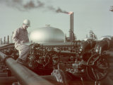 Oil Worker Records Data While Standing Amid Refinery Equipment Photographic Print by Joseph Baylor Roberts