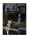 Woman Sits in Front of a Non-Operational Mill in Ambleside Photographic Print by Clifton R. Adams