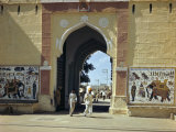 People Walk Through an Old City Gate Leading to a Bazaar Street Photographic Print by Volkmar K. Wentzel