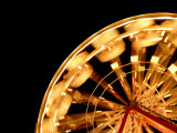 Arc of a Ferris Wheel in Motion Is Bright Against the Night Sky Photographic Print by  White & Petteway