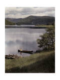 Woman Canoes to the Shore of Echo Lake Photographic Print by Clifton R. Adams