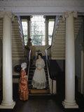 Three Women Wearing Colonial Dresses Stand in an Old Mansion Photographic Print by W. Robert Moore