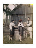 Three Adults, Dressed in Sheepskin, Stand with a Wooden Bucket Photographic Print by Wilhelm Tobien