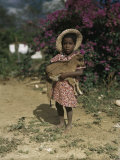 Small Girl with Dusty Bare Feet Hugs Her Tiny Goat Photographic Print by Edwin L. Wisherd