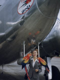 Flight Attendant Stands in Front of an Airplane with Two Macaws Photographic Print by Luis Marden
