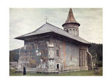 Man Stands Beside a Painted Church Built by Stephen the Great Photographic Print by Wilhelm Tobien