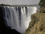Tourists Look Small Against Backdrop of Victoria Falls Photographic Print by W. Robert Moore