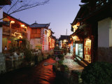 Shops and Restaurants Along a Stone Cobbled Street in Lijiang at Night Photographic Print by  xPacifica