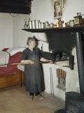 Woman Bakes Bread in Her One Room House Photographic Print by Howell Walker