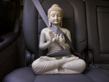 Serene Buddha Sculpture in a Car,Strapped in by a Seatbelt Photographic Print by  White & Petteway