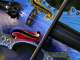 Bow Draws a Melody from the Strings of a Colorful, Painted Violin Photographic Print by White & Petteway