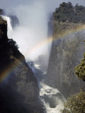Rainbow Spans Gorge Below Victoria Falls, Mist Rises from Falls Photographic Print by W. Robert Moore