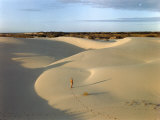 Cowboy Stands in Large Expanse of Windblown Encroaching Sand Photographic Print by Howell Walker