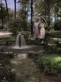 Two Women Pose Beside an Artesian Well Photographic Print by Edwin L. Wisherd