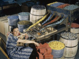 Woman Uses an Automated Sorter to Pack Marbles of All Colors Photographic Print by Volkmar K. Wentzel