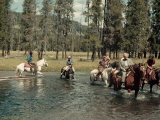 Yellowstone Visitors Ride Horseback across Firehole River Photographic Print by Edwin L. Wisherd