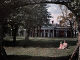 Woman and Child Sit in the Grass in Front of Monticello Photographic Print by Edwin L. Wisherd