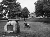 Man Sits on a Bench by a Monument to John O'Neill at Havre De Grace Photographic Print by Edwin L. Wisherd