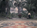 Man Stands by a Carpet of Flowers Located in the Cathedral Square Photographic Print by Wilhelm Tobien