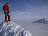 Polar Explorer Stands Atop Nemtinov Peak, Surrounded by Glaciers Photographic Print by Gordon Wiltsie
