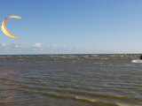 Young Man Kiteboarding in the Gulf of Riga Photographic Print by Keenpress 