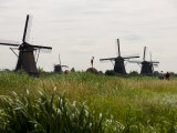 Windmills in a Field in the Netherlands Photographic Print by Mattias Klum